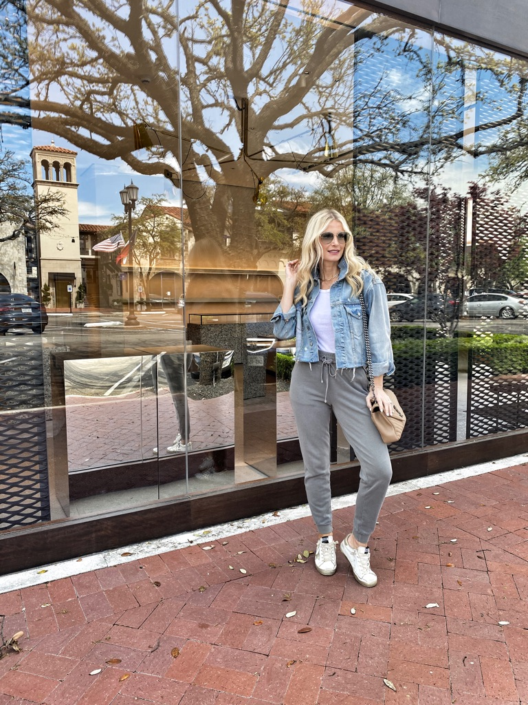 Dallas fashion blogger wearing a denim jacket and grey joggers
