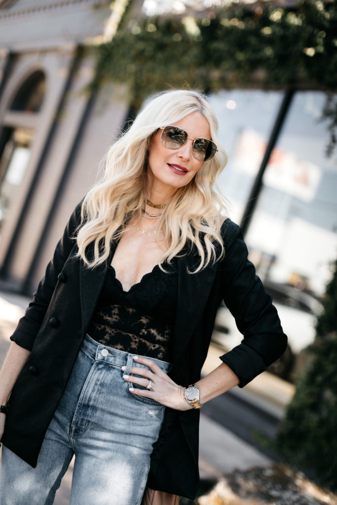 Style blogger wearing a black lace cami with a black oversized blazer