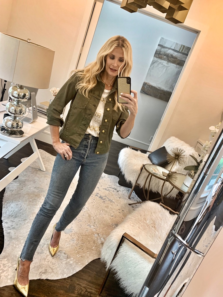 Dallas style blogger wearing an army green jacket and denim