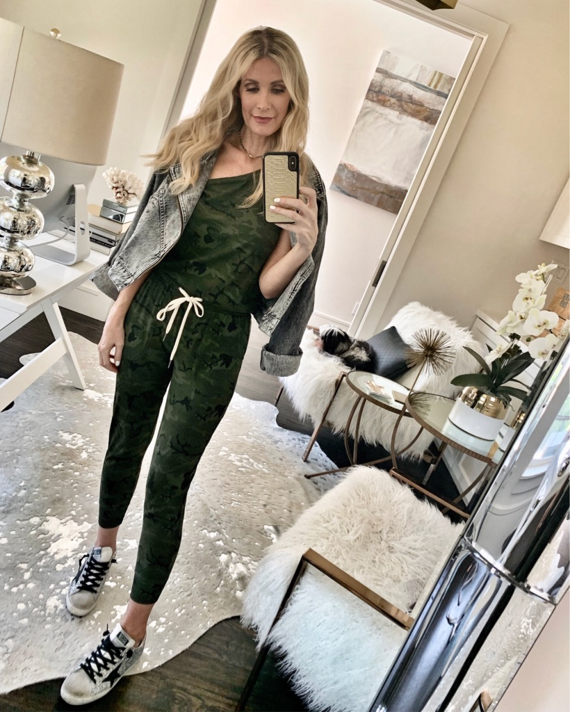 Dallas blogger wearing a jumpsuit and Golden Goose sneakers