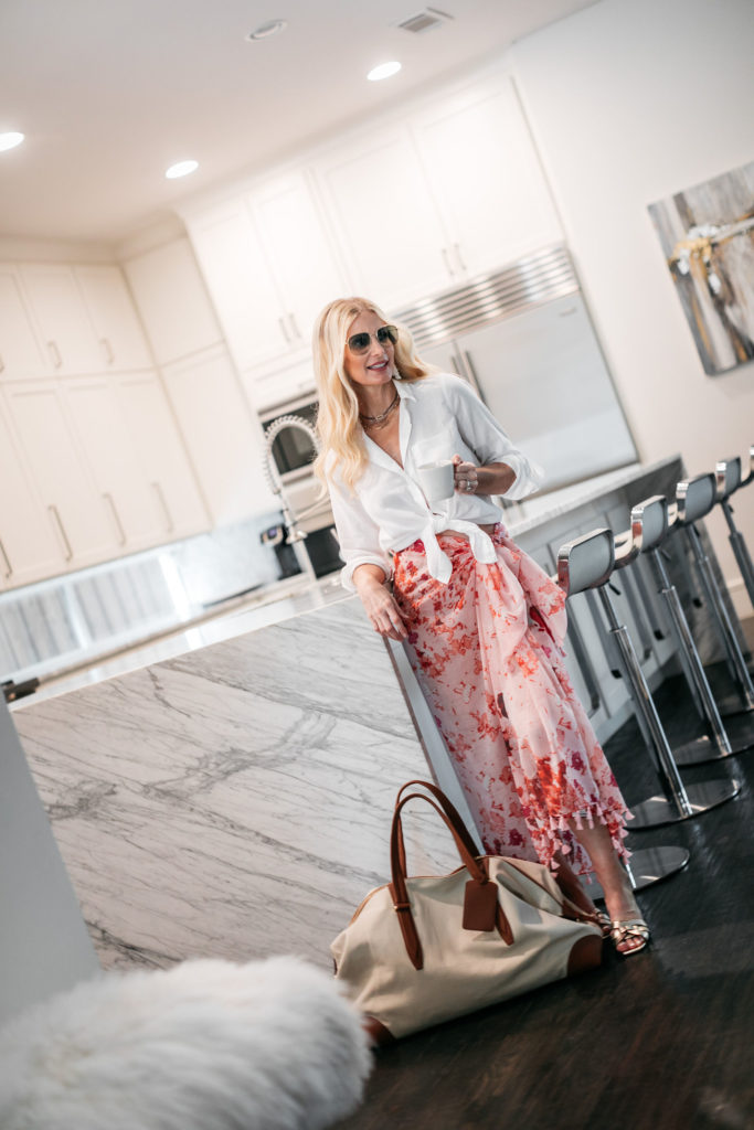 Dallas blogger wearing a floral skirt and Gucci sunglasses