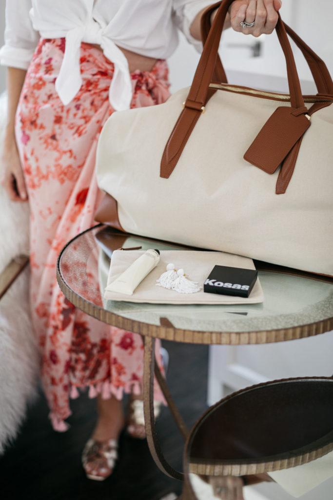 Dallas blogger carrying a travel bag
