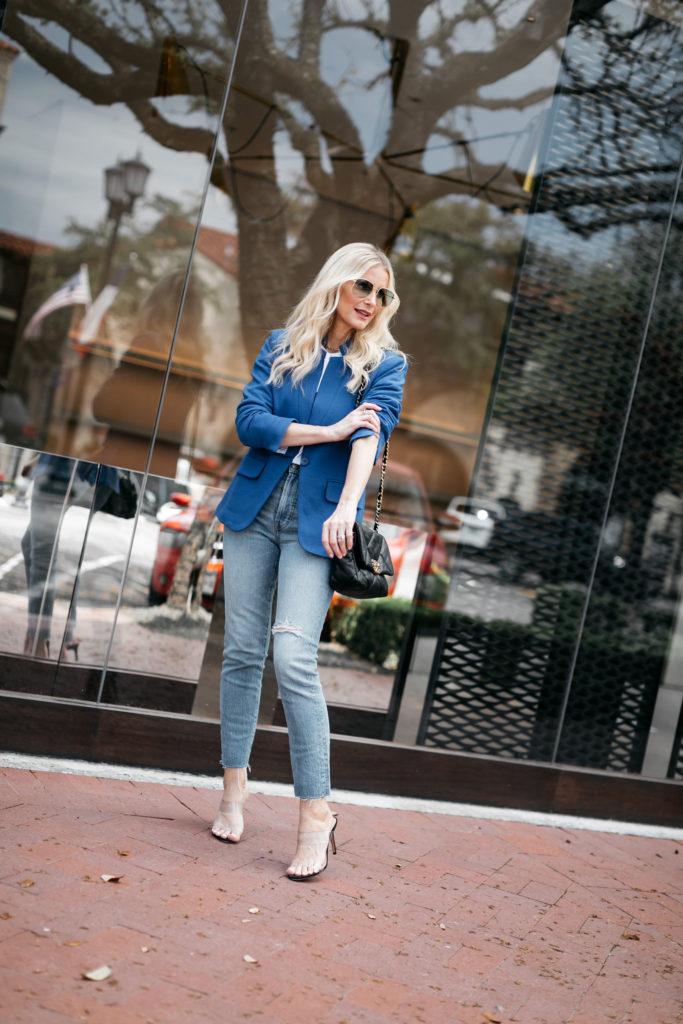 Fashion blogger wearing a blue blazer and light wash denim