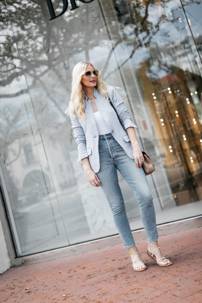 Dallas style influencer wearing light wash jeans and a blazer
