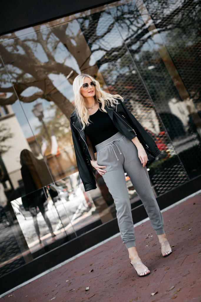 Dallas blogger wearing joggers and a leather jacket