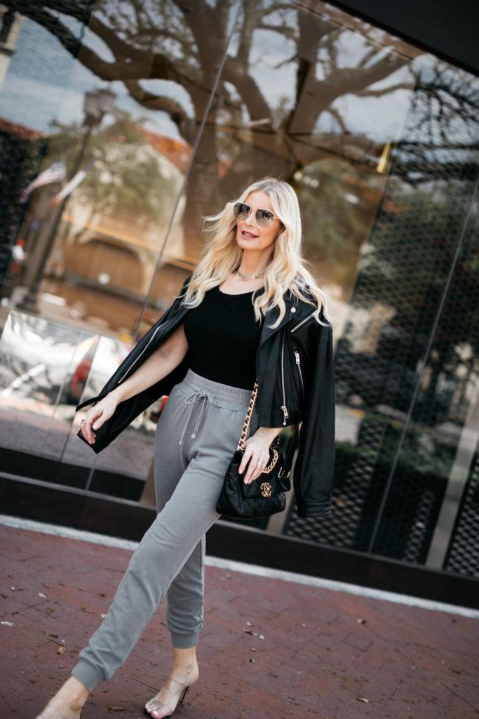 Chanel 19 handbag and a black leather jacket