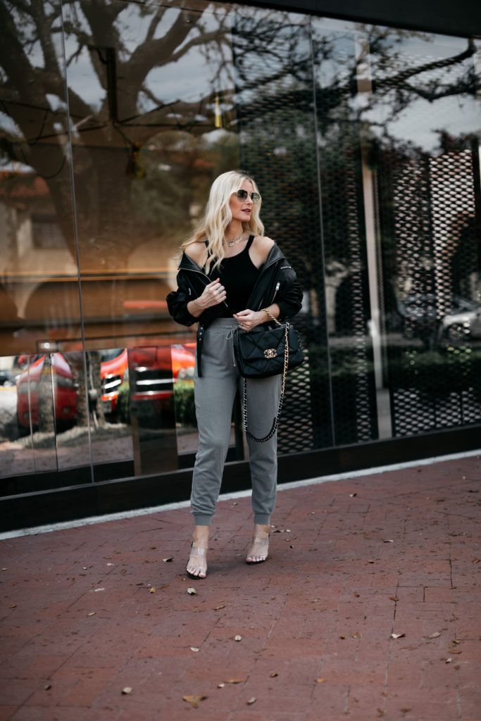 Dallas blogger wearing joggers and a black leather jacket