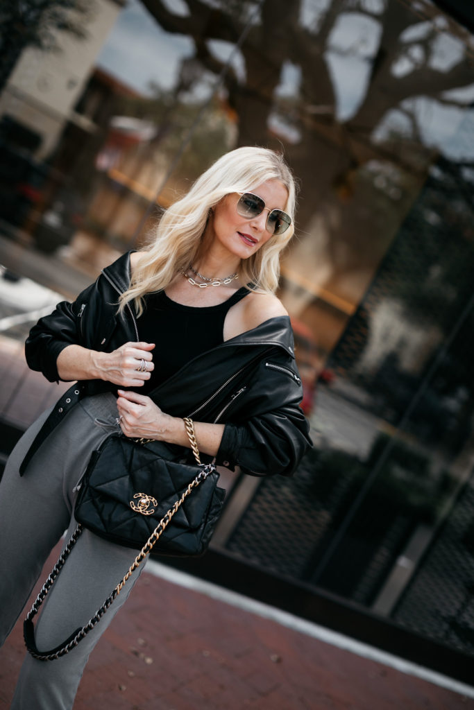 Dallas blogger carrying a Chanel 19 handbag