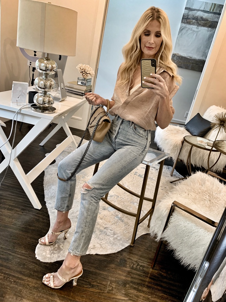 Dallas fashion blogger wearing a sheer blouse and heels