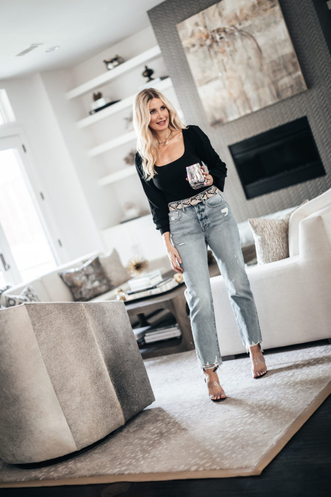 Dallas style blogger wearing a black long sleeve top and light wash denim