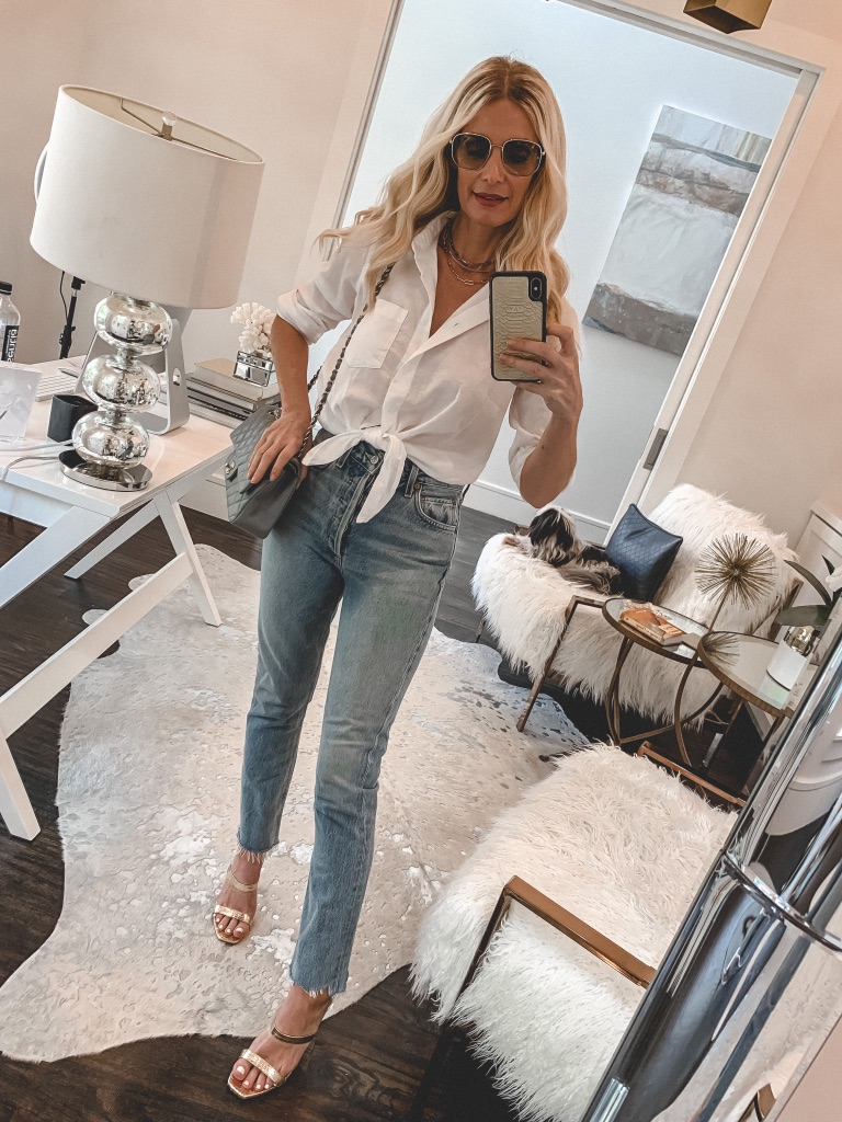 Influencer wearing a white button-down and jeans
