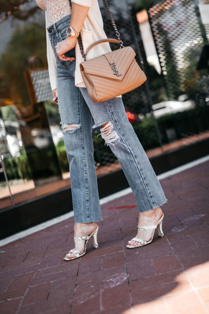 Fashion blogger wearing gold accessories and snakeskin mules