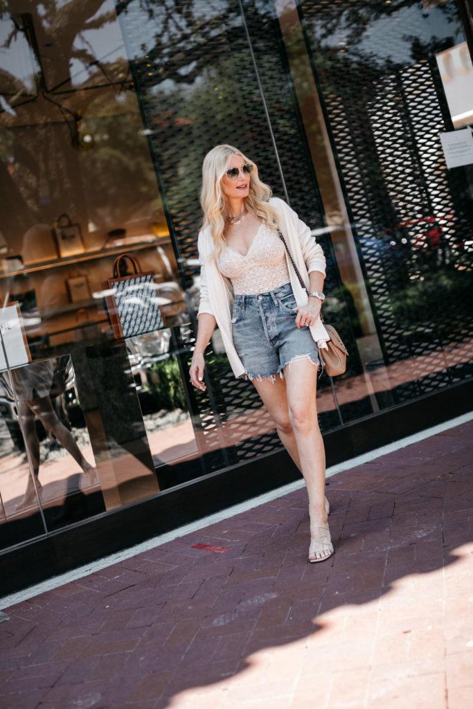 Dallas fashion blogger wearing denim shorts and heels