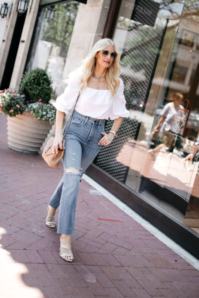 Dallas blogger wearing a white summer top and denim