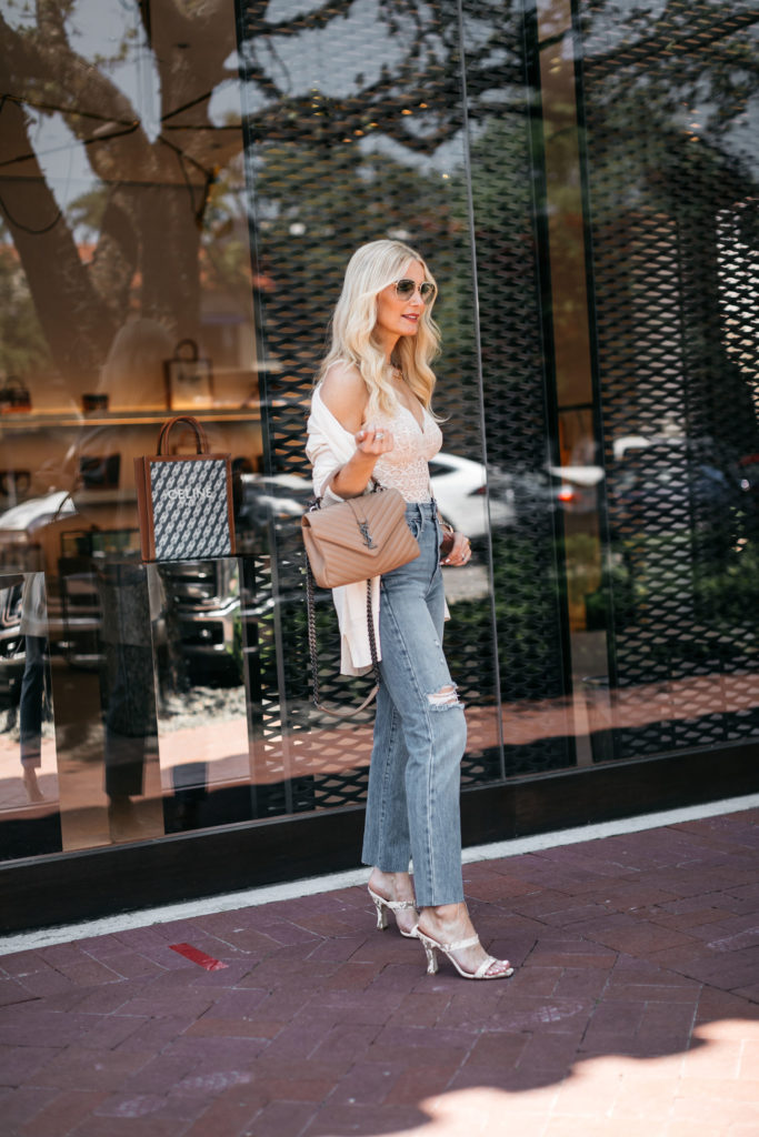Style blogger wearing a lace bodysuit and straight leg denim