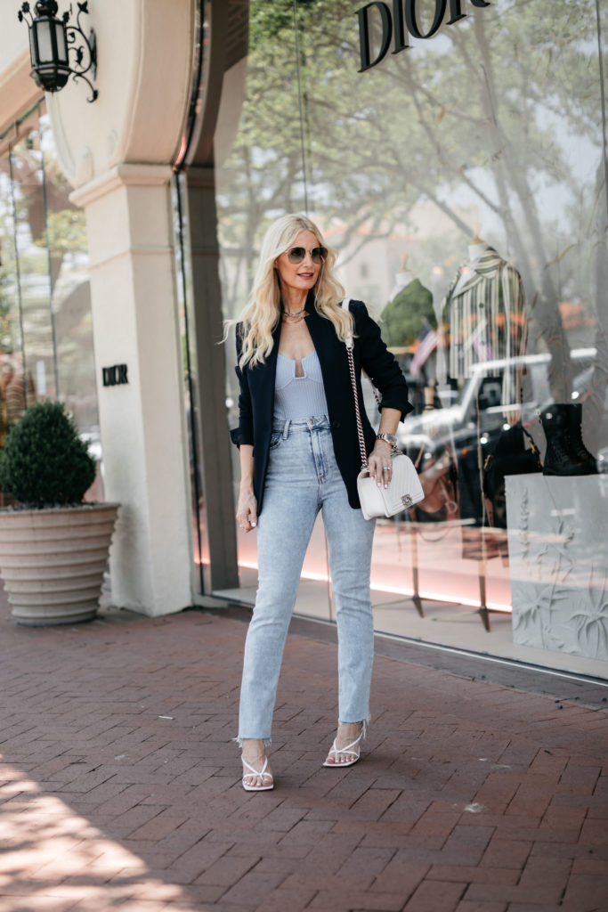 Dallas blogger wearing a black blazer and a periwinkle tank with light wash denim