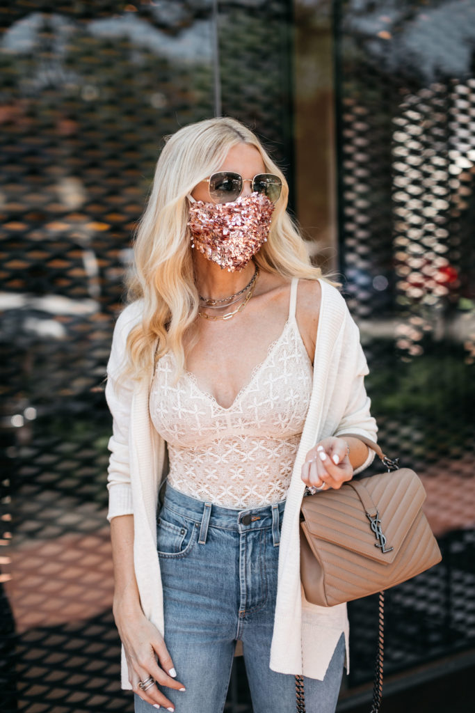 Dallas blogger wearing a gold face mask and a lace cami