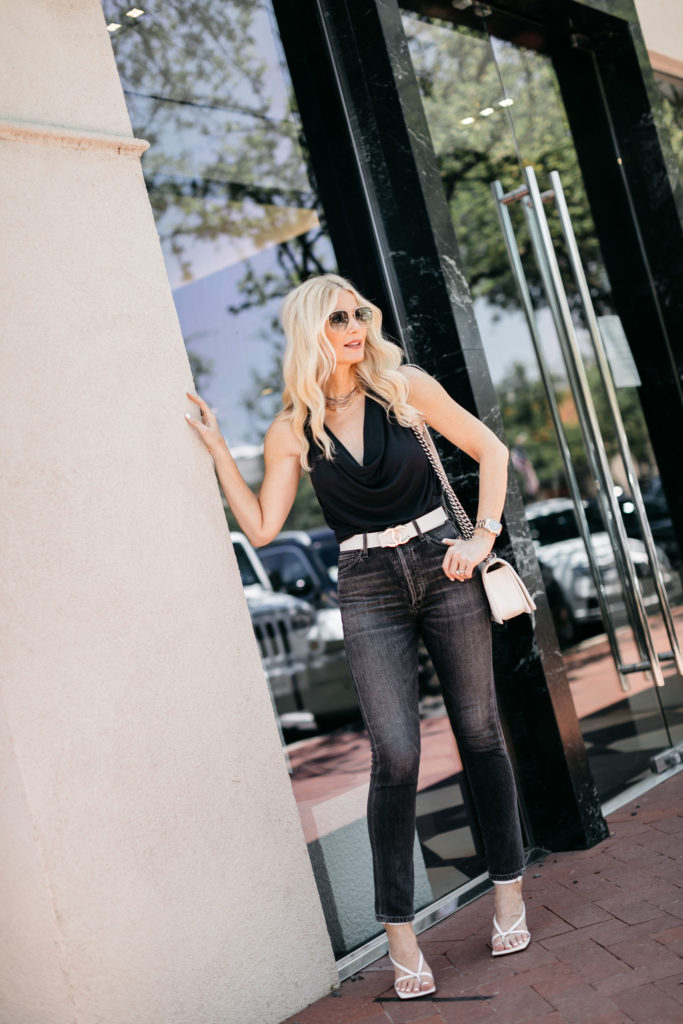 Dallas blogger wearing a black summer top and black denim