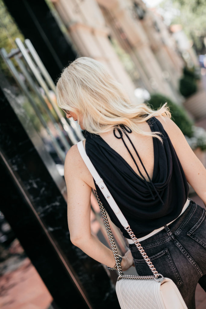 Dallas influencer wearing a black date night top with an open back