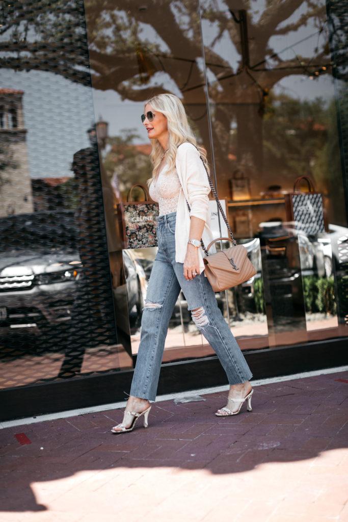 Dallas fashion blogger wearing a white blazer and ripped denim