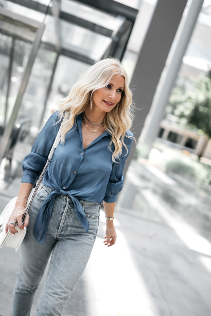 Dallas blogger wearing a silk blue blouse and denim