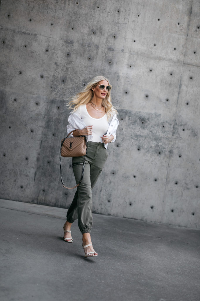 Dallas blogger wearing a white tank and green cargo joggers