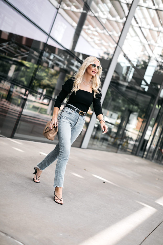 Dallas fashion blogger wearing a black top and light wash denim