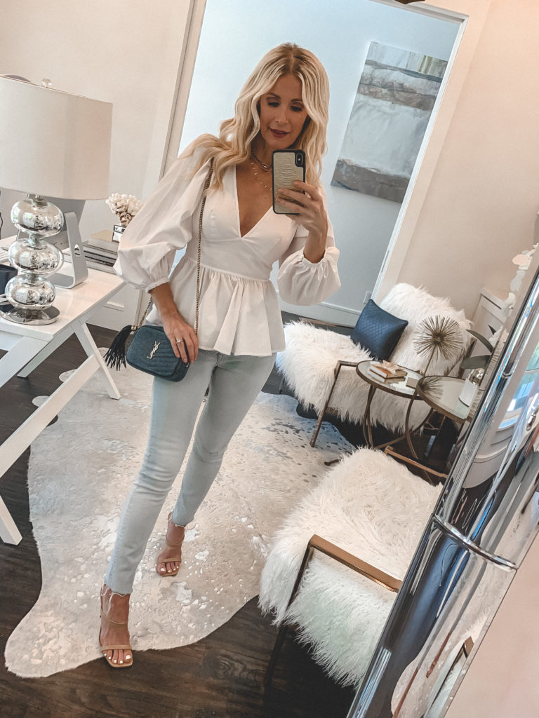 Dallas fashion blogger wearing a balloon sleeve white top and light wash denim for spring and summer