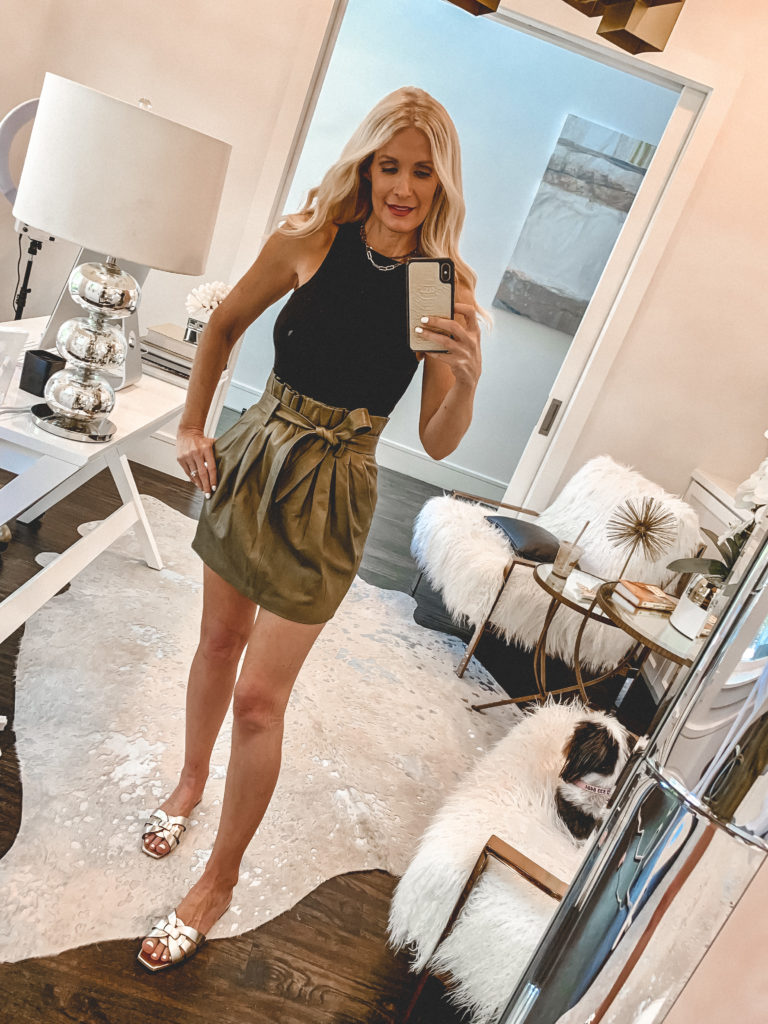 Dallas blogger wearing a black tank with a skirt and summer gold sandals