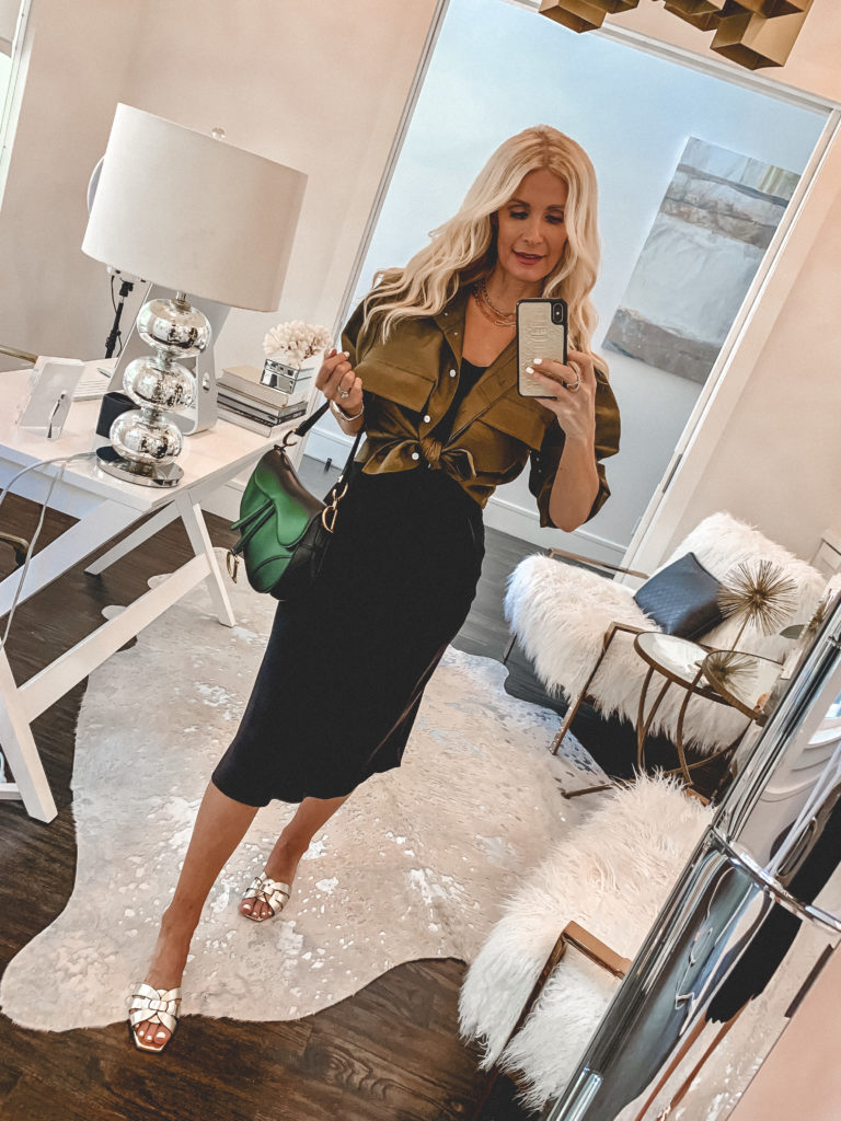 Dallas blogger wearing a black slip dress with an olive green button down