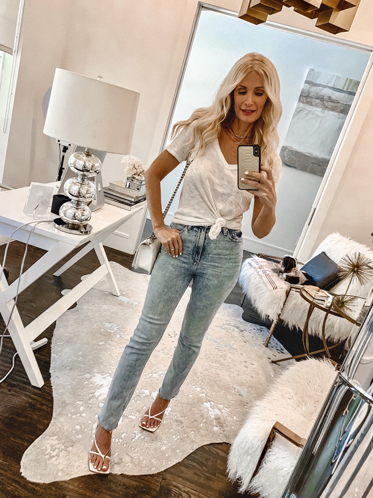 Style blogger wearing a simple white tee and light wash denim