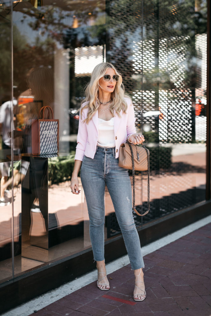 Style blogger wearing a white bodysuit and cropped pink blazer