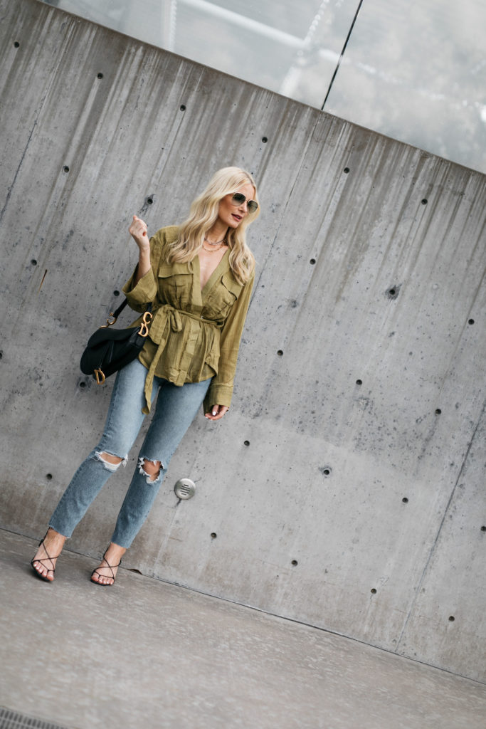 Dallas blogger wearing an olive green top