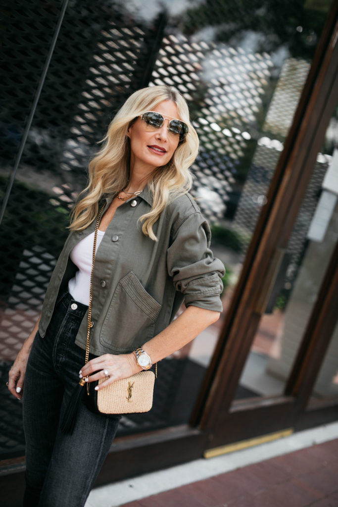 Style blogger wearing Gucci aviators and army green jacket