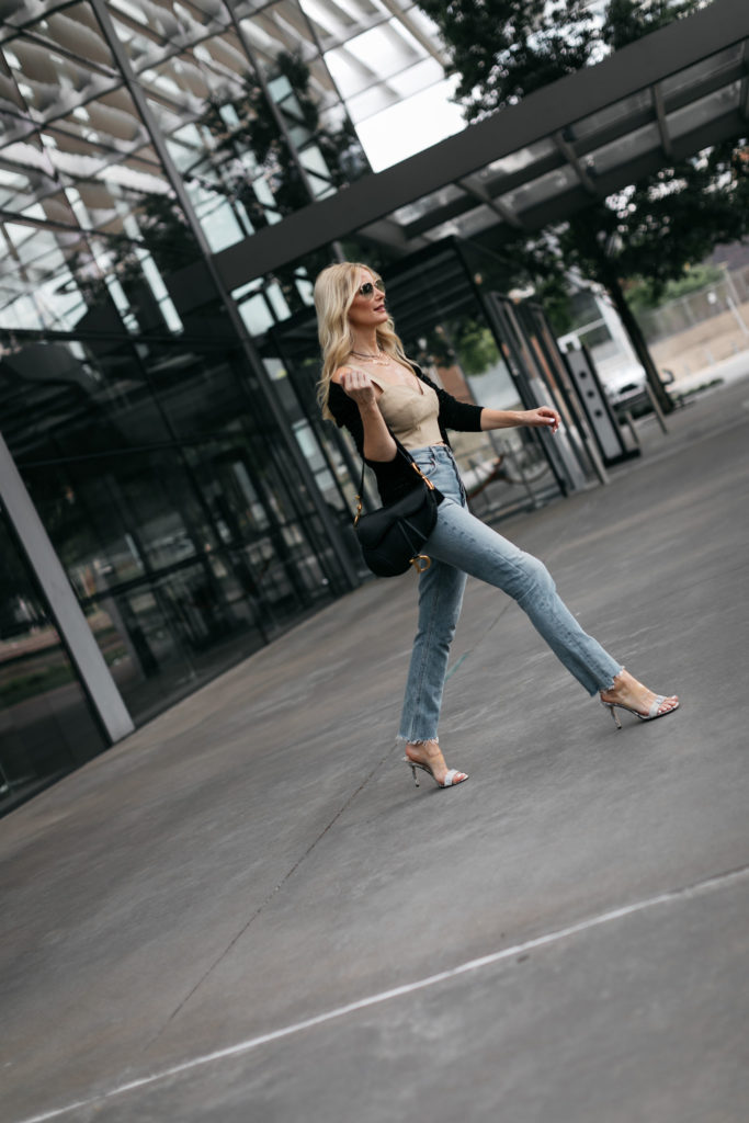 Dallas fashion blogger wearing a black knit cardigan and light wash denim