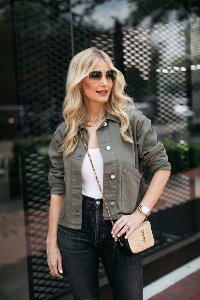 Dallas blogger wearing an army green jacket and black denim