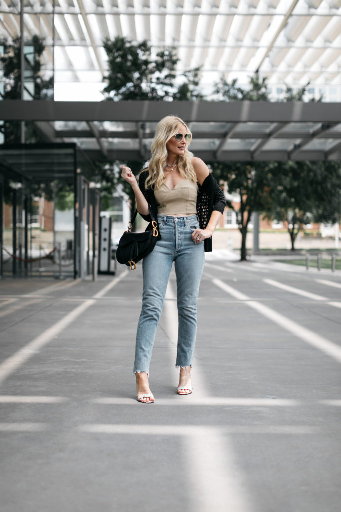 Dallas style blogger wearing Agolde light wash denim and a summer crop top