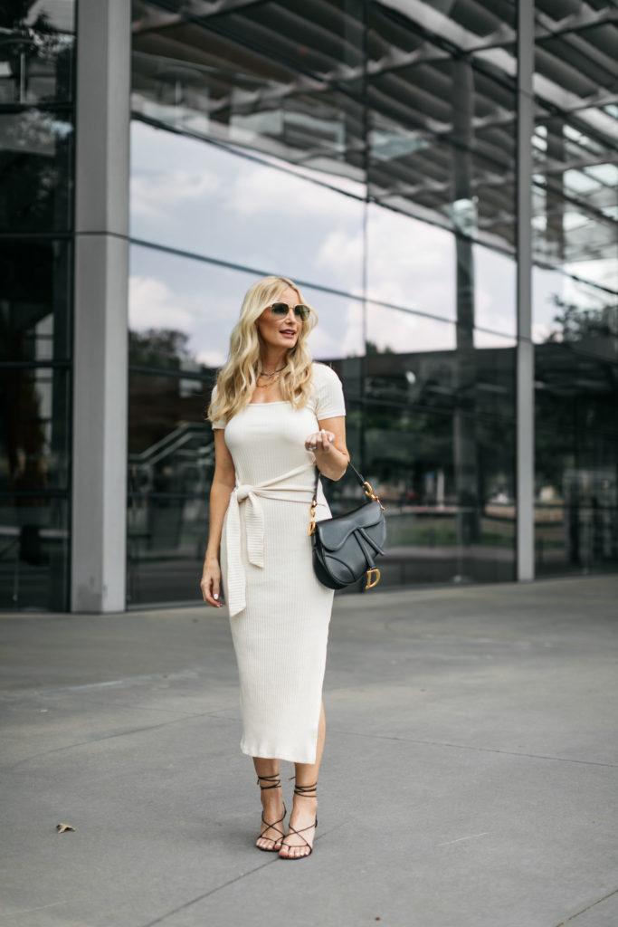 Dallas blogger wearing a white midi dress with black heels