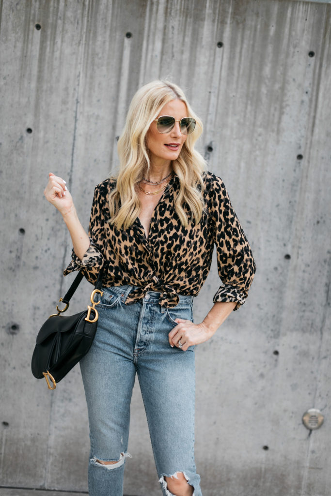Dallas blogger carrying a Dior saddle bag