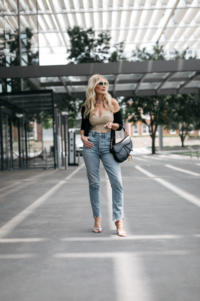 Dallas blogger wearing light wash denim and crop top