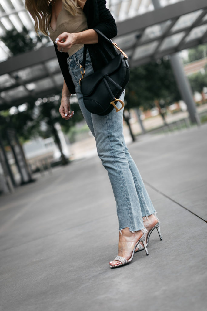Dallas blogger wearing agolde jeans and snakeskin heels