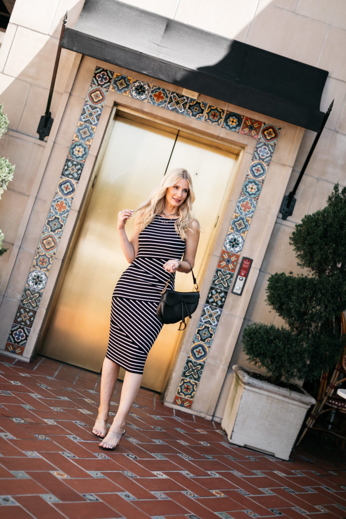 Dallas influencer wearing a striped midi dress