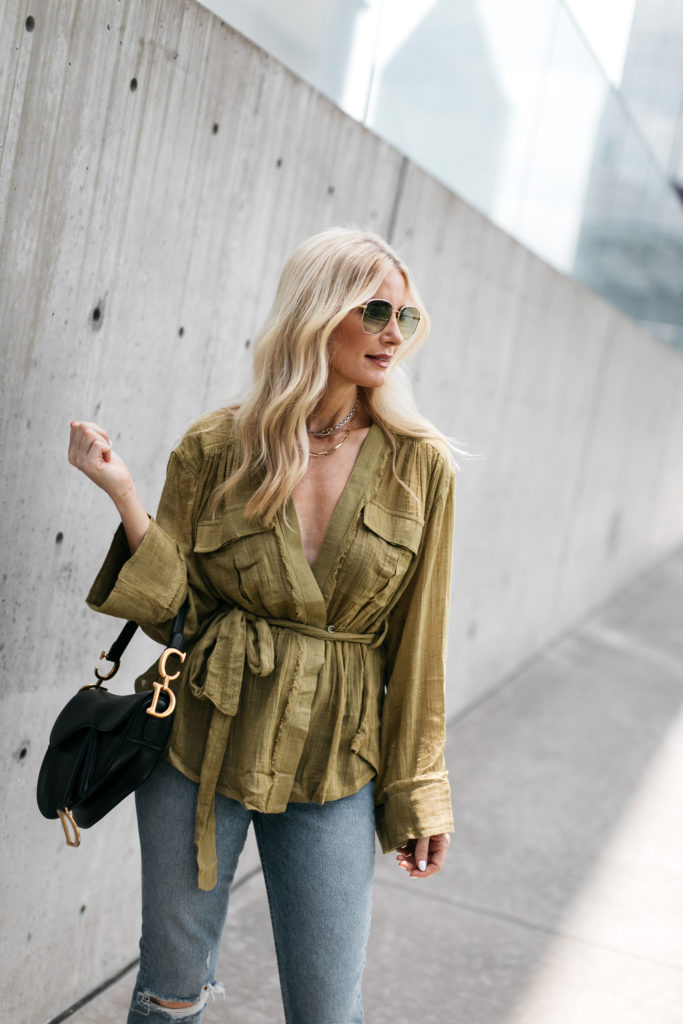 Style blogger wearing an olive green summer top