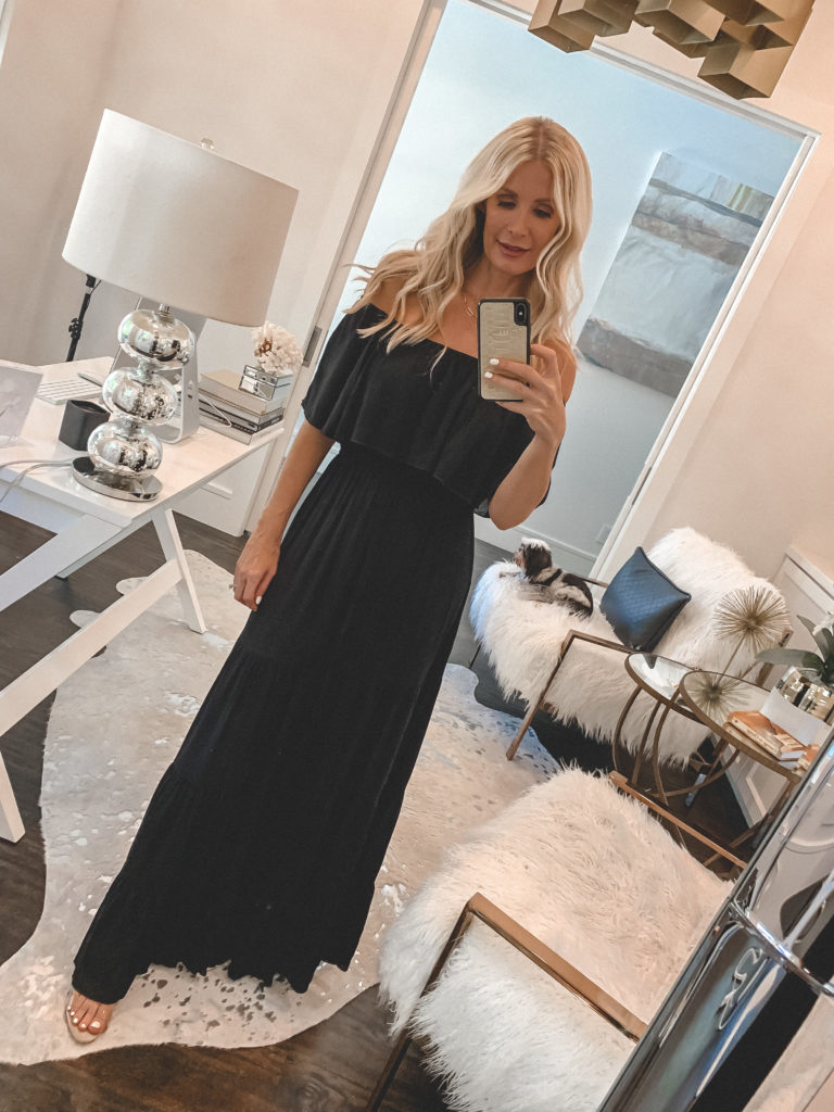 Fashion blogger wearing an off-the-shoulder black maxi dress