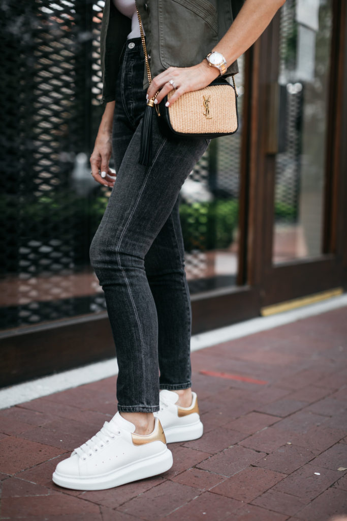 Style influencer wearing black denim and YSL handbag