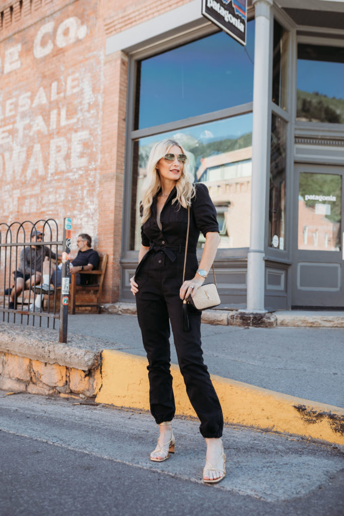 Over 40 blogger wearing a denim jumpsuit