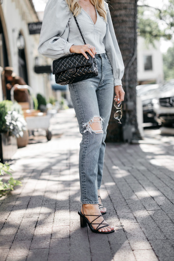 Dallas blogger wearing black strappy heels and vintage denim