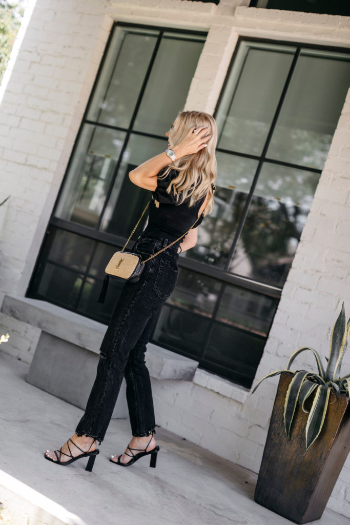 Fashion blogger wearing a black on black outfit in the summer