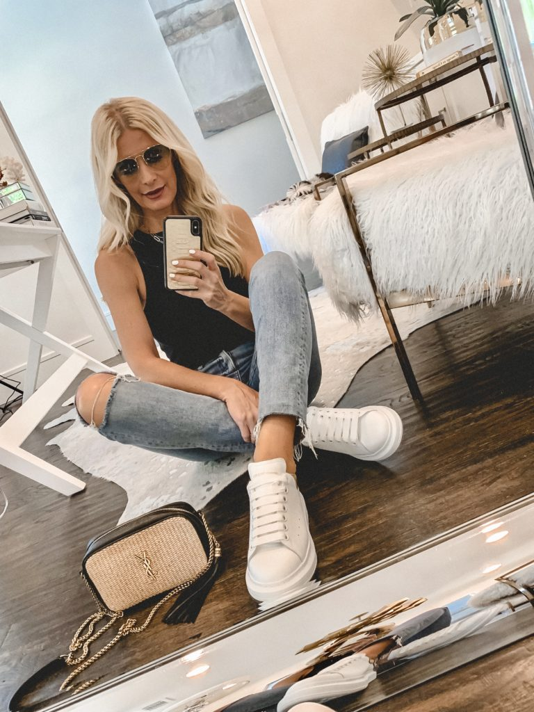 Dallas blogger wearing a black tank bodysuit and white sneakers