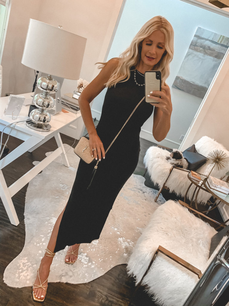 Style influencer wearing a black summer midi dress and gold strappy heels